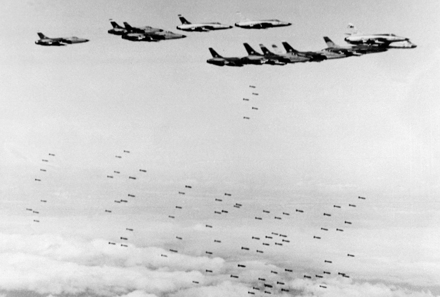 6 U.S. Army F105 Thunderchief fighter-bombers drop bombs on military and strategic targets in north Vietnam on February 8, 1966 AFP.jpg
